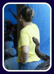 lady with snake behind her